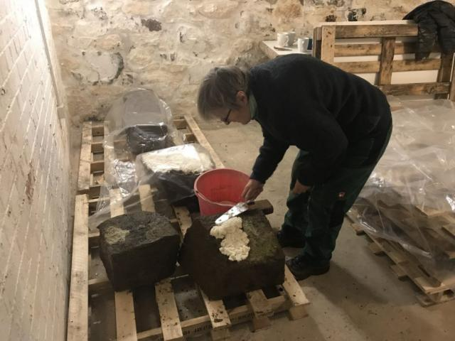 The Cunaide Stone after being moved inside the Heritage Centre. Sue is seen here applying paper pulp to absorb the moisture.